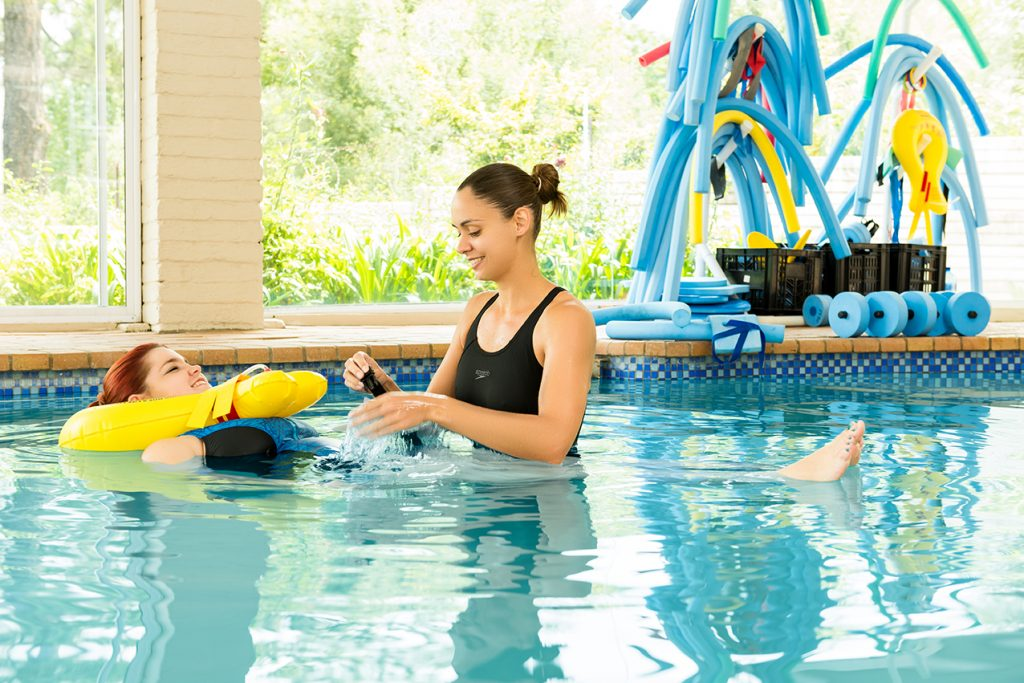 Woman in water aqua therapy with Fish and Field Biokineticists offer pre and post-operative rehabilitation through hydrotherapy in Bryanston, Johannesburg