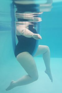 Ankylosing Spondylitis Exercises and Aqua-Therapy cycling legs with breast stroke arms poses demonstrated by Jenna-Lee Field at Fish and Field Biokineticists in Bryanston
