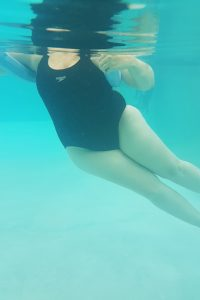 Ankylosing Spondylitis Exercises and Aqua-Therapy pendulum poses demonstrated by Jenna-Lee Field at Fish and Field Biokineticists in Bryanston