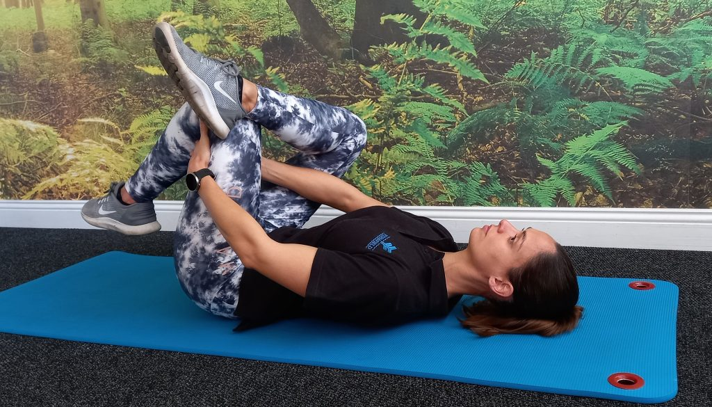 Glutes stretch and toning exercise demonstrated by Jenna-lee Field at Fish and Field Biokinetics in Bryanston, Sandton