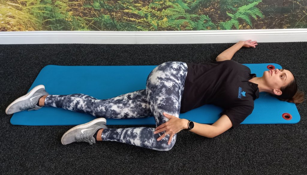 Lateral structure stretch and toning exercise demonstrated by Jenna-lee Field at Fish and Field Biokinetics in Bryanston, Sandton