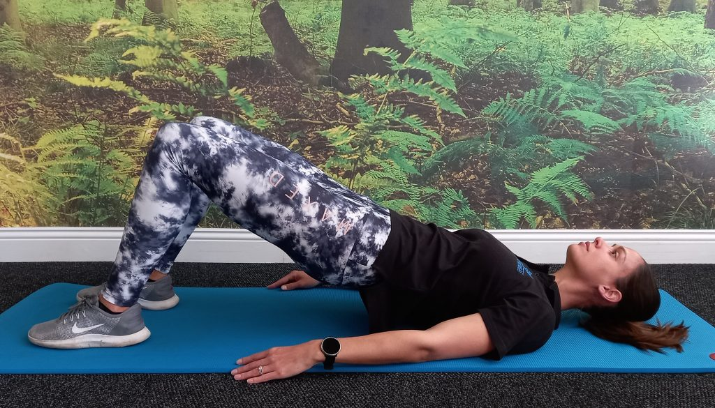 Bridging toning exercise demonstrated by Jenna-lee Field at Fish and Field Biokinetics in Bryanston, Sandton