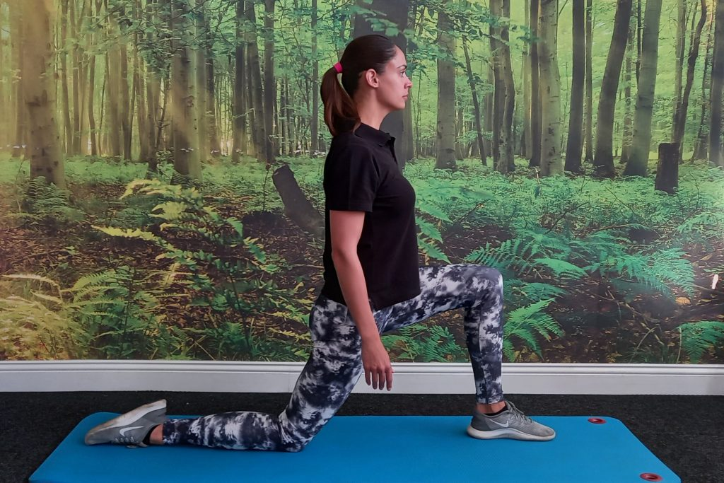 Hip flexor stretch and toning exercise for low back paindemonstrated by Jenna-lee Field at Fish and Field Biokinetics in Bryanston, Sandton